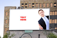 Blank billboard and young businessman Stock Photos
