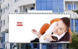 Blank billboard  and young woman Royalty Free Stock Photos