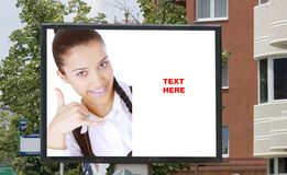 Blank billboard  and young woman Stock Image