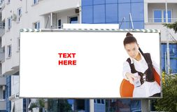 Blank billboard  and young woman Royalty Free Stock Image
