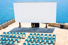Blank billboard for your advertesing and seats against sea Royalty Free Stock Photos