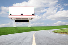 Blank billboard for your advertisement on road curve. Royalty Free Stock Photo