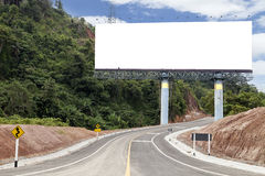 Blank billboard for your advertisement on road curve. Royalty Free Stock Photos