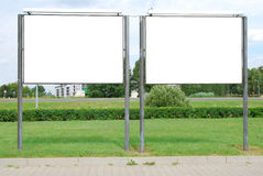 Blank billboards. Two blank billboards on grass royalty free stock images