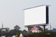 blank billboards in city with blue sky stock photography