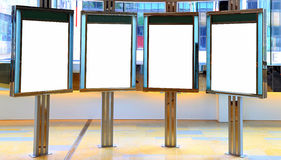 Blank billboards inside a shopping mall. Four blank or empty billboards inside a shopping mall stock photography