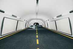 Blank billboards inside the tunnel with cars Stock Photos
