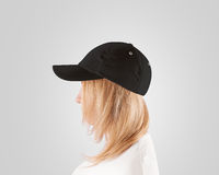 Blank black baseball cap mockup template, women head, profile, isolated. Blank black baseball cap mockup template, wear on woman head, profile, isolated. Woman Royalty Free Stock Photography