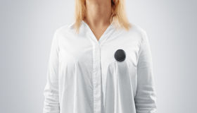 Blank black button badge mockup pinned on the womans chest Royalty Free Stock Photography