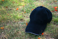 Blank Black cap on green grass Royalty Free Stock Photography