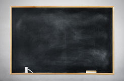 Blank Black Chalkboard on a Gray Background Stock Image