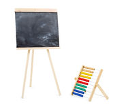 Blank black chalkboard and multi-colored abacus isolated Stock Photography