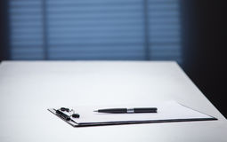 Blank black clipboard with a pen Royalty Free Stock Image