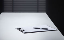 Blank black clipboard with a pen Stock Photo