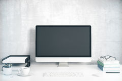 Blank black computer screen with office accessories on white tab Stock Photo