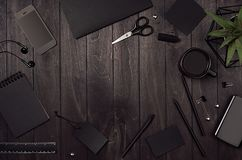 Blank black corporate stationery as work place with copy space on dark stylish wood background. Branding mock up for branding, graphic designers presentations Stock Photography