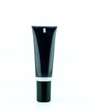 Blank black cream tube or cosmetic bottle isolated on white background Stock Images