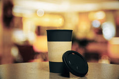 Blank black cup of coffee on a table at restaurant Royalty Free Stock Photo