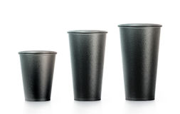 Blank black disposable paper cup mock ups isplated, large. Medium and smal, 3d rendering. Empty polystyrene coffee drinking mug mockup front view. Clear plain Stock Images