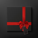 Blank, black gift box with red ribbon and price tag. Stock Photo