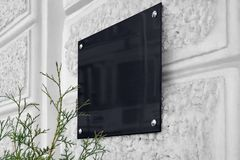 Free Blank Black Glass Signboard On Gray Textured Wall Mockup Royalty Free Stock Image - 162932346