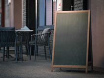 Blank black menu board on sidewalk. 3d rendering royalty free stock photography