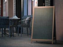 Blank black menu board on sidewalk. 3d rendering. Blank black menu board on sidewalk at the evening. 3d rendering royalty free stock photography