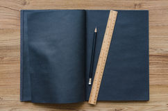 Blank black notebook with black pencil and ruler Royalty Free Stock Images