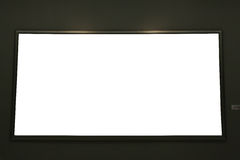 Blank black painting frame on black wall Royalty Free Stock Images