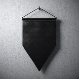 Blank black pennant hanging concrete wall. Ready for your business information. High detailed texture material. Abstract backgroun Stock Photography