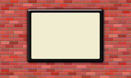 Blank black picture frame on the brick wall. Blank black picture frame on red brick wall Royalty Free Stock Photo