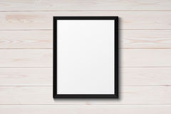 Blank black picture frame on the grunge wood texture Stock Photos