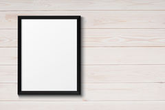 Blank black picture frame on the grunge wood Stock Image