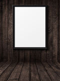 Blank black picture frame on the grunge wood texture Royalty Free Stock Photo
