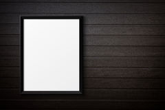 Blank black picture frame on the painted wood Royalty Free Stock Images