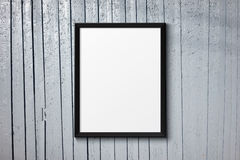 Blank black picture frame on the painted wood Stock Photography