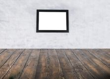 Blank black picture frame and wooden floor and grunge background. stock image