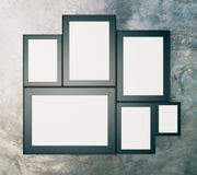 Blank black picture frames on concrete wall, mock up, 3D Render Stock Image