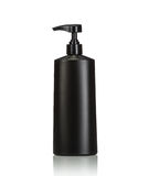 Blank black pump plastic bottle used for shampoo or soap. Studio Royalty Free Stock Images