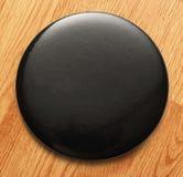 Blank black round badge. Blank single black round badge in closeup royalty free stock images