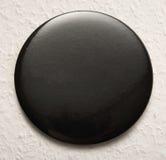 Blank black round badge. Blank single black round badge in closeup stock image
