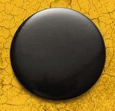 Blank black round badge. Blank single black round badge in closeup royalty free stock photography