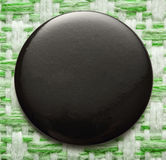 Blank black round badge. Blank single black round badge in closeup stock images