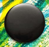 Blank black round badge. Blank single black round badge in closeup royalty free stock photos