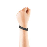 Blank black rubber wristband mockup on hand, isolated Stock Photos