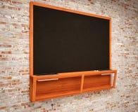 Blank Black School Chalk Board. BlaBlank Black School Chalk Boardnk on brick wall Stock Images