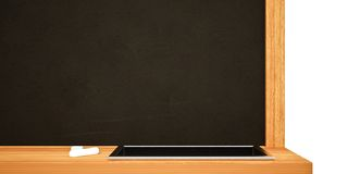 Blank Black School Chalk Board. BlaBlank Black School Chalk Boardnk on wall Stock Photography