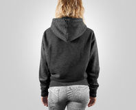 Blank black sweatshirt mock up back side view, isolated. Female wear grey plain hoodie mockup. Hoody design presentation. Clear loose model. Gray jumper Stock Photo