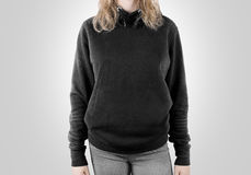 Blank black sweatshirt mock up isolated. Female wear dark hoodie. Mockup. Plain hoody design presentation. Clear gray loose overall model. Pullover for print Royalty Free Stock Photography