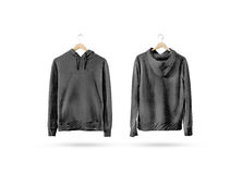 Blank black sweatshirt mockup set hanging on wooden hanger royalty free stock images